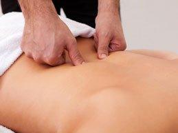 точечный массаж поясницы